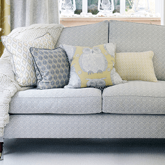 Reupholstery cream textured sofa with yellow patterned cushions