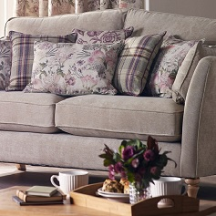 Reupholstery Beige sofa with patterned purple cushions