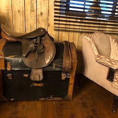 Home Accessories Old fashioned trunk with saddle on top