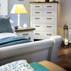 Purbeck Tall chest of draws in a bedroom setting. Rowico Bedroom and Dining Furniture Collection